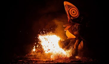 dancers kicking fire at the Fire Dance Festival in PNG